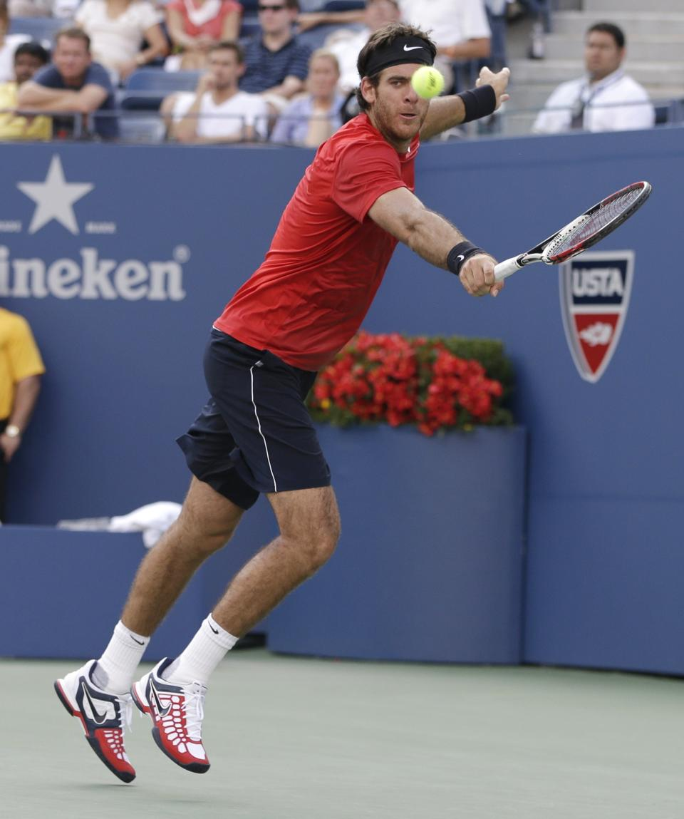 Juan Martin Del Potro of Argentina returns a shot during his win over Andy Roddick in the quarterfinals during the 2012 US Open tennis tournament,  Wednesday, Sept. 5, 2012, in New York. (AP Photo/Darron Cummings)