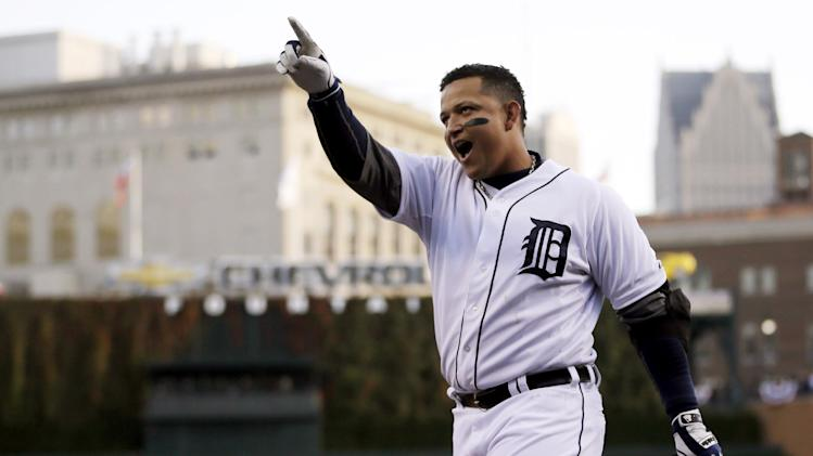 FILE - In this Oct. 18, 2012, file photo, Detroit Tigers' Miguel Cabrera celebrates after hitting a two-run home run during the fourth inning of Game 4 of the American League championship series against the New York Yankees in Detroit. Cabrera and Mike Trout are the top contenders for the American League Most Valuable Player award, to be announced Thursday, Nov. 15, 2012. (AP Photo/Matt Slocum, File)