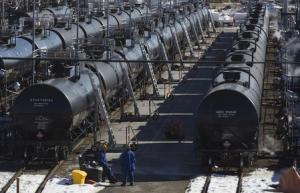 File photo of Irving Oil workers inspecting rail cars carrying crude oil at the Irving Oil rail yard terminal in Saint John, New Brunswick