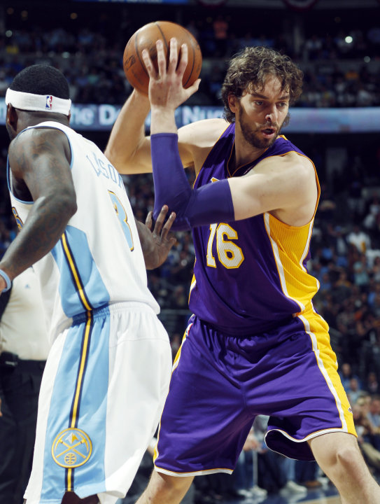 Los Angeles Lakers forward Pau Gasol, right, of Spain, pulls in a loose ball in front of Denver Nuggets guard Ty Lawson during the first quarter of Game 6 of a first-round NBA basketball playoff serie