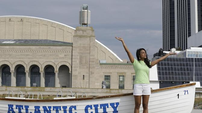 Miss America 2014 Nina Davuluri poses for photographers before engaging in the traditional dipping of the toes in the Atlantic Ocean the morning after being crowned Miss America, Monday, Sept. 16, 2013, in Atlantic City, N.J. Davuluri represented New York. (AP Photo/Julio Cortez)