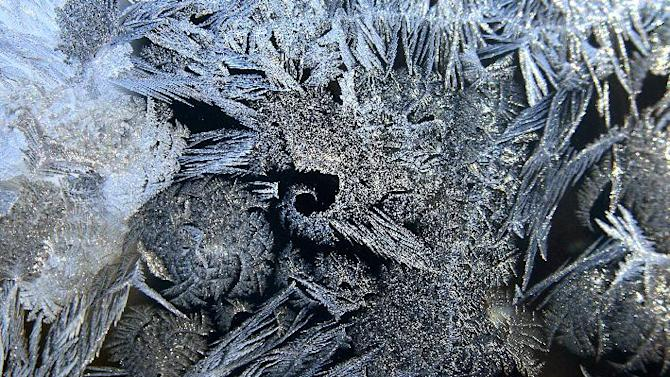 Ice crystals form frost on the window of a home in Medina, Minn., as the area experiences subzero temperatures on Monday, Jan. 21, 2013. (AP Photo/The Star Tribune, Richard Sennott)