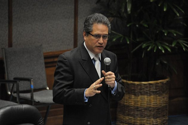 Sen. Kalani English from Maui speaks on the Senate floor at the Hawaii Capitol on March 5, 2013 in Honolulu. A bill introduced by English on behalf of Aerosmith frontman Steven Tyler passed the Senate. (AP Photo/Anita Hofschneider)