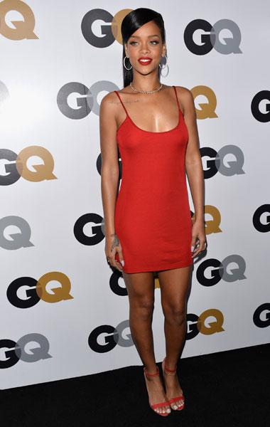 Rihanna: The current GQ cover star takes a cue from Garth by donning the same hue but keeps it simple in a Calvin Klein spaghetti-strap mini dress. The 24-year-old displayed her toned legs and cute physique in the slip. She adds drama with a beautiful diamond necklace and large hoop earrings. (Photo by Alberto E. Rodriguez/Getty Images)