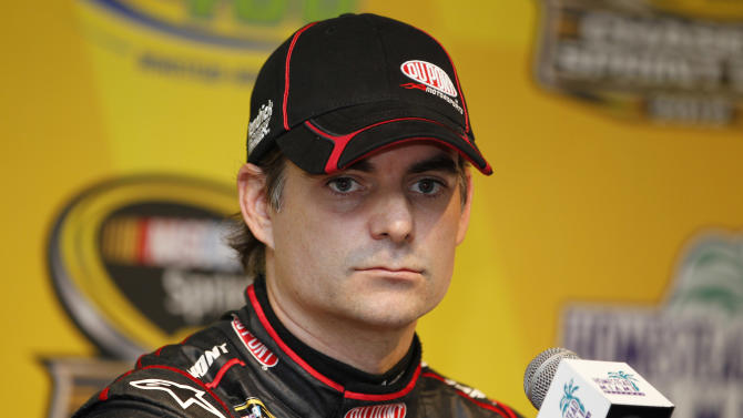 Driver Jeff Gordon looks on during a news conference for Sunday's NASCAR Sprint Cup Series auto race at Homestead-Miami Speedway in Homestead, Fla., Friday, Nov. 16, 2012. (AP Photo/Terry Renna)