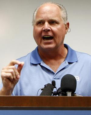 "FILE - In this Jan. 1, 2010 file photo, conservative talk show host Rush Limbaugh speaks during a news conference at The Queen's Medical Center looks on in Honolulu, after he was rushed to the hospital after experiencing chest pains during a vacation. Limbaugh's opponents are starting a radio campaign against him Thursday, seizing upon the radio star's attack of a Georgetown law student as a ""slut"" for a long-term effort aimed at weakening his business. (AP Photo/Chris Carlson, file )"