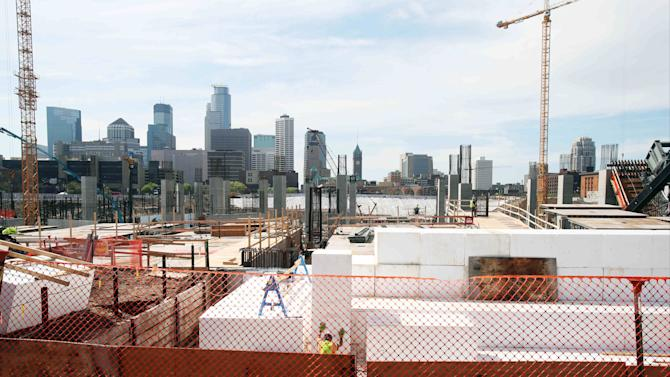 The Minneapolis skyline rises in the background as work continues on the new Minnesota Vikings NFL football stadium,Tuesday, March 20, 2014, in Minneapolis. Minneapolis will host the 2018 Super Bowl after a vote by owners Tuesday rewarded the city for its new stadium deal. (AP Photo/Jim Mone)