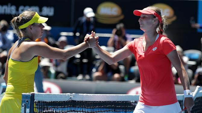 Germany's Angelique Kerber, left, congratulates Russia's Ekaterina Makarova following during their fourth round match at the Australian Open tennis championship in Melbourne, Australia, Sunday, Jan. 20, 2013. (AP Photo/Aaron Favila)