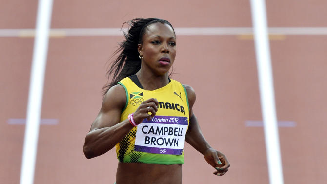 "File- This Aug. 3, 2012 file photo shows Jamaica's Veronica Campbell-Brown competing in a women's 100-meter heat during the athletics in the Olympic Stadium at the 2012 Summer Olympics, London. Campbell-Brown, or ""VCB"" as she's simply known in sprinting circles, tested positive for a banned diuretic at a meet in May and will serve a suspension while anti-doping officials rule on the positive drug test, island track officials announced Tuesday June 18, 2013. (AP Photo/Martin Meissner, File)"