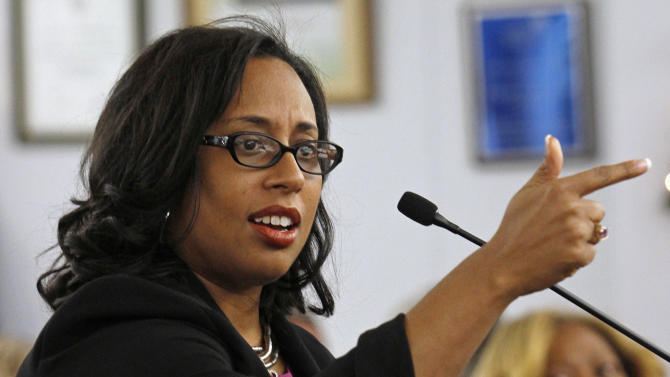 FILE - In this Dec. 15, 2012 file photo, Illinois state Sen. Toi Hutchinson speaks during a candidate presentation at the 2nd Congressional District slating meeting in South Holland, Ill. Hutchinson dropped her bid Sunday, Feb. 17, 2013 for the U.S. House seat vacated by Jesse Jackson Jr., narrowing the field and consolidating key support behind another Democrat in a race where gun control has emerged as a central issue. (AP Photo/John Smierciak, File)