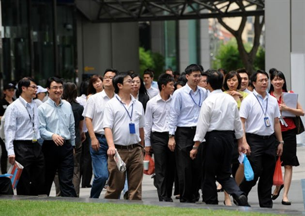 A survey revealed that nearly 9 in 10 Singaporeans are working beyond their official hours. (Thinkstock photo)
