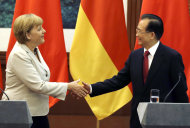 <p>               German Chancellor Angela Merkel, left, shakes hands with Chinese Premier Wen Jiabao after a joint press conference at the Great Hall of the People in Beijing Thursday, Aug. 30, 2012. (AP Photo/Ng Han Guan)