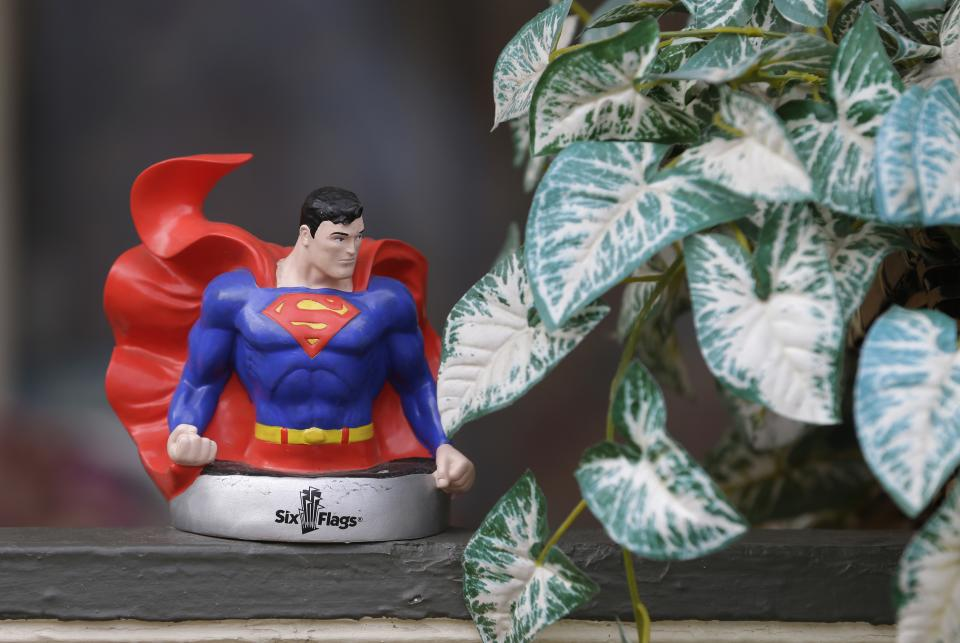 In this Tuesday, April 2, 2013 photo shows a superman figure on the porch where Jerry Siegel lived in Cleveland. Superman collaborators Siegel and Joe Shuster lived several blocks apart in the Glenville neighborhood which shaped their lives, dreams for the future and their imagery of the Man of Steel. (AP Photo/Tony Dejak)