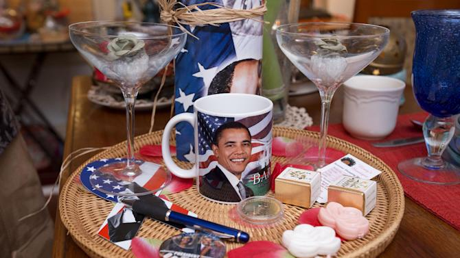In this Thursday, Dec. 20, 2012, photo, items that will be presented to guests during the inauguration of President Barack Obama are seen inside Aunt Bee's Little White House B&B, in Washington, the six-room bed and breakfast in northeast Washington still had two rooms available for the presidential inauguration as of the week before Christmas, with rates starting at $225 a night. (AP Photo/Jacquelyn Martin)