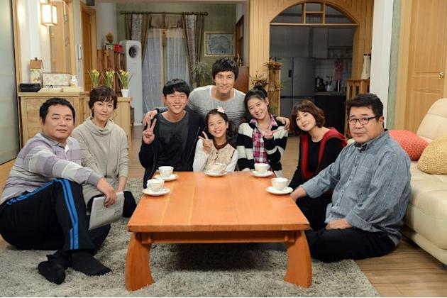 "South Korean actors in the popular soap opera, ""Cheer Up, Mr. Kim,"" which features as a major supporting character a young North Korean defector, are shown in this KBS photo on November 11,"
