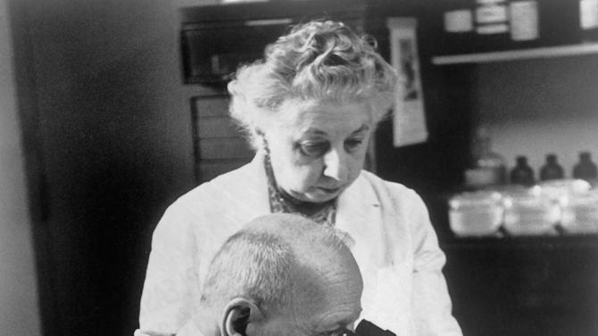 This undated photo provided by the American Cancer Society shows Dr. George Papanicolaou, inventor of Pap test, foreground, and his wife, who was also his research partner, in their lab. In the late 1940s, the American Cancer Society advocated wide adoption of the Pap test, which has resulted in a 70 percent decrease in uterine and cervical cancer. (AP Photo/American Cancer Society)