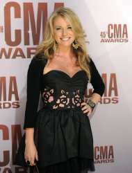 FILE - In this Nov. 9, 2011 file photo, Deana Carter arrives at the 45th Annual CMA Awards in Nashville. Court records show Carter filed for separation from her husband Brandon Malone in Los Angeles on Tuesday, Nov. 13, 2012. The couple were married in October 2009, but separated in August 2011, according to Carters filing citing irreconcilable differences. (AP Photo/Evan Agostini, File)