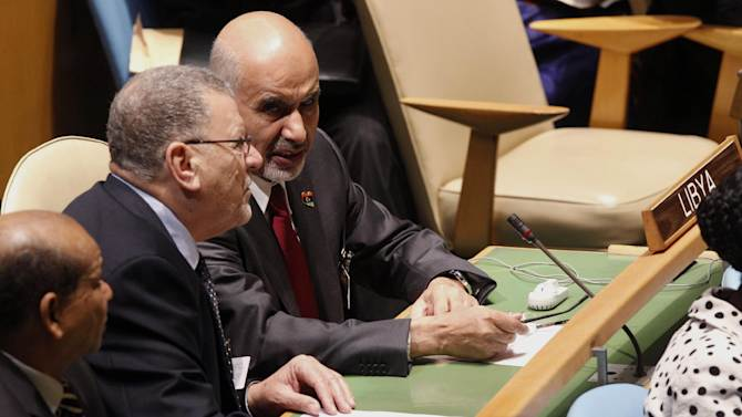 Libya's President Mohammed el-Megaref, right, speaks to a member of his delegation during the 67th session of the United Nations General Assembly at U.N. headquarters Tuesday, Sept. 25, 2012.  (AP Photo/Mary Altaffer)