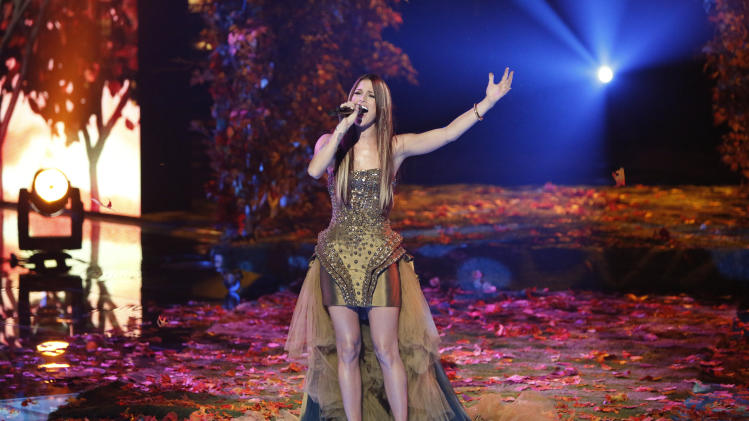 """This Monday, Dec. 17, 2012 file photo released by NBC shows Cassadee Pope performing on """"The Voice,"""" """"Live Show"""" Episode 323A on the part one season 3 finale in Los Angeles.  Three contestants, Pope, Terry McDermott and Nicholas David vie for the title in the NBC reality show. (AP Photo/NBC, Tyler Golden)"""