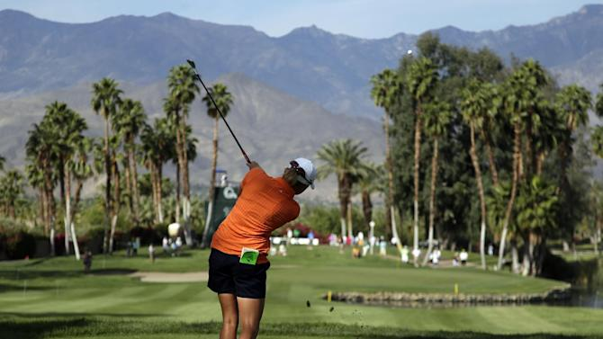 Stacy Lewis hits from the tee on the 14th hole during the first round of the LPGA Kraft Nabisco Championship golf tournament in Rancho Mirage, Calif. Thursday, April 4, 2013. (AP Photo/Chris Carlson)
