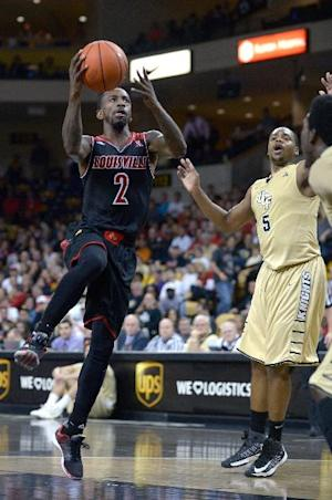 No. 14 Louisville runs past UCF 90-65