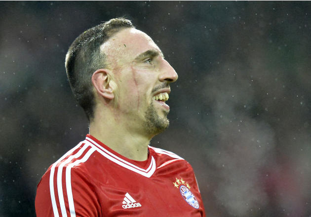 Bayern's thre- times scorer Franck Ribery of France smiles  during the German Bundesliga soccer match between Werder Bremen and Bayern Munich in Bremen, Germany, Saturday, Dec. 7, 2013. Bayern def