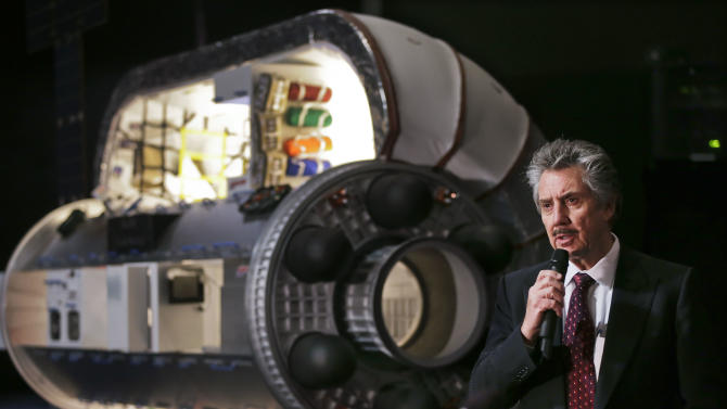 Bigelow Aerospace founder and president Robert Bigelow answers questions from members of the media during a news conference, Wednesday, Jan. 16, 2013, in Las Vegas. Bigelow spoke about the company's new contract to provide NASA with a habitat module for the International Space Station. Pictured with Bigelow is a one third scale model of a BA 330 module, similar in function to the what the new Bigelow Expandable Activity Module will be. (AP Photo/Julie Jacobson)