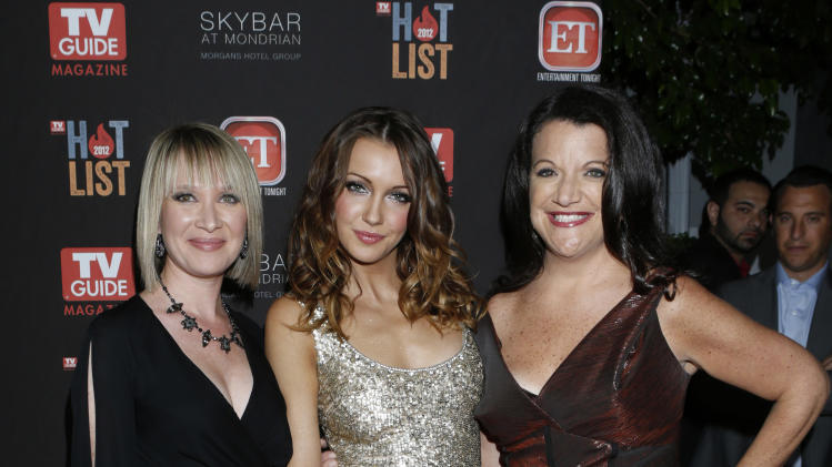TV Guide Magazine publisher Lori O'Connor, Katie Cassidy and TV Guide Magazine Editor-in-Chief Debra Birnbaum attends TV Guide Magazine's 2012 Hot List Party at Skybar at the Mondrian Hotel on November 12, 2012 in West Hollywood, California.  (Photo by Todd Williamson/Invision/AP Images)