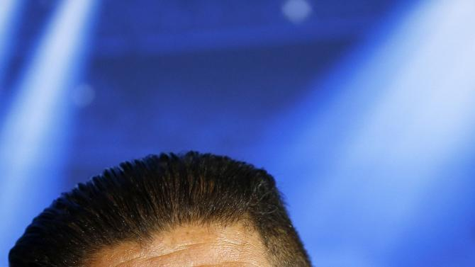Atletico Madrid's coach Diego Simeone attends a news conference at Vicente Calderon stadium, on the eve of their Champions League soccer match against Malmo, in Madrid