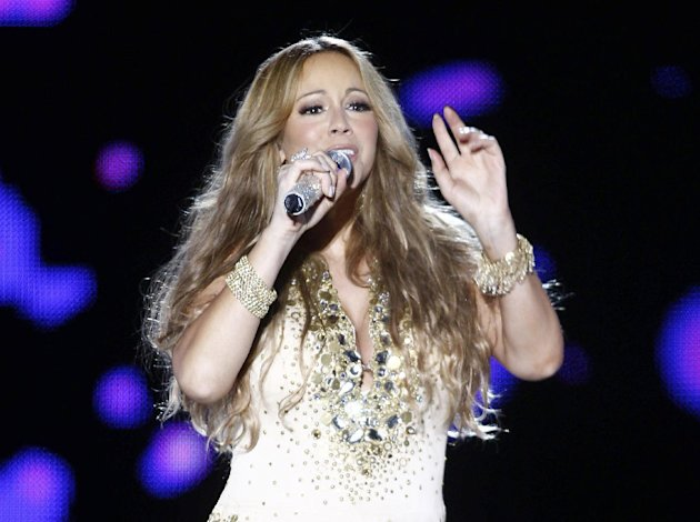 FILE - This May 26, 2012 file photo shows U.S. Singer Mariah Carey performing on stage during a concert at the Mawazine Festival in Rabat, Morocco. A person familiar with the singing competition series &quot;American Idol&quot; negotiations say Carey is being pursued to join the judging panel of the Fox talent competition. The source requested anonymity because of the private nature of negotiations. (AP Photo/Abdeljalil Bounhar, file)