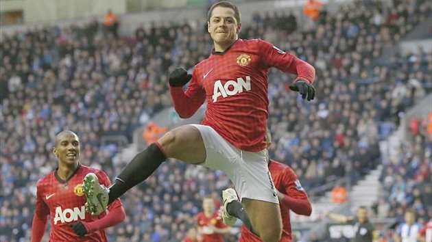 Manchester United's Javier Hernandez celebrates scoring against Wigan Athletic during their English Premier League match at The DW Stadium in Wigan