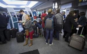 People line up for information about their flights at La Guardia airport in New York