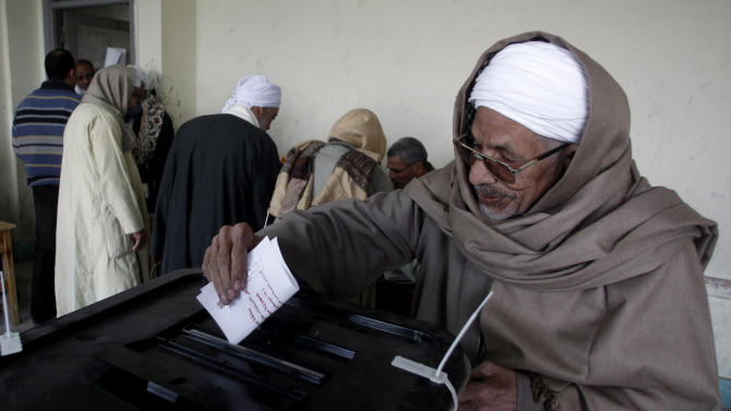An Egyptian man casts his vote during a referendum on a disputed constitution drafted by Islamist supporters of President Mohammed Morsi in Cairo, Egypt, Saturday, Dec. 15, 2012. Egyptians were voting on Saturday on a proposed constitution that has polarized their nation, with Morsi and his Islamist supporters backing the charter, while liberals, moderate Muslims and Christians oppose it. (AP Photo/Petr David Josek)