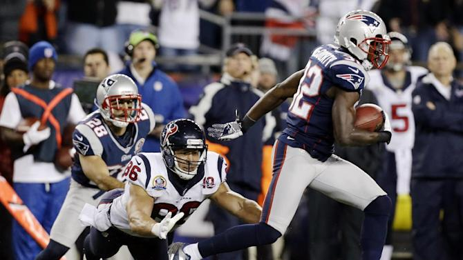 New England Patriots free safety Devin McCourty (32) runs from Houston Texans fullback James Casey (86) after intercepting a pass from quarterback Matt Schaub during the first quarter of an NFL football game in Foxborough, Mass., Monday, Dec. 10, 2012. (AP Photo/Elise Amendola)