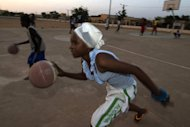 "Fatoumata, 16, plays basketball at the former ""Sharia Square"" in central Gao, on February 26, 2013. Since the departure of the Islamists, who occupied the city for nine months, following the arrival of the French and Malian forces, the central square of Gao is once again called ""Independence square."""