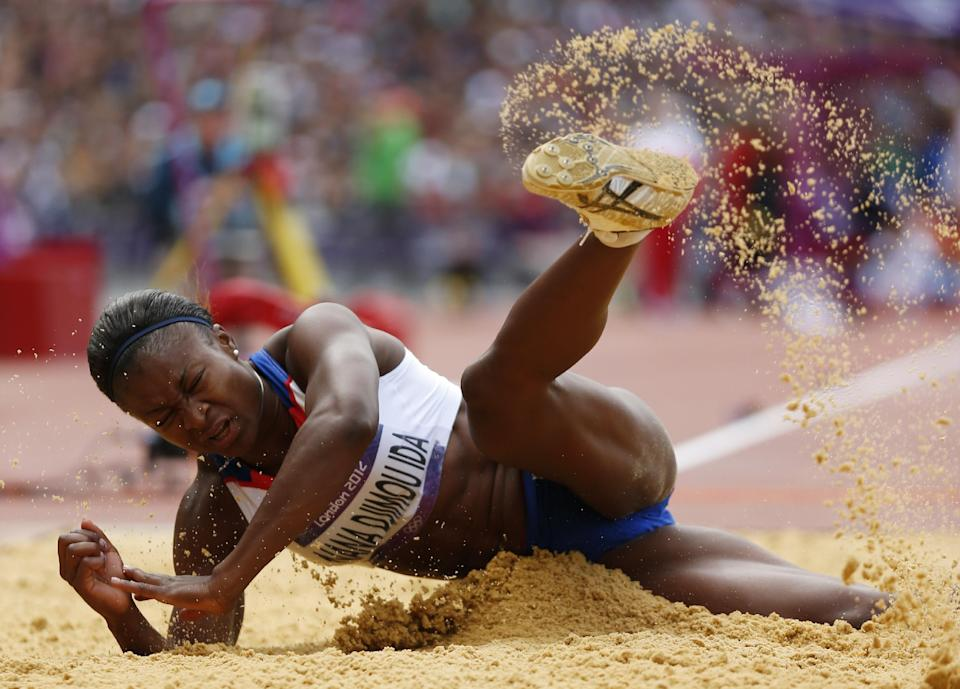 France's Antoinette Nana Djimou Ida competes in the long jump heptathlon during the athletics in the Olympic Stadium at the 2012 Summer Olympics, London, Saturday, Aug. 4, 2012. (AP Photo/Matt Dunham)