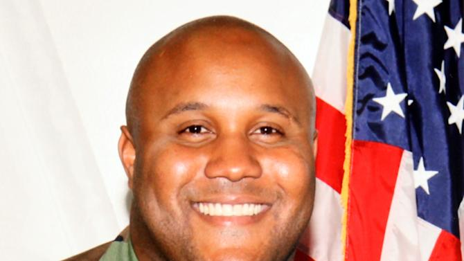 FILE - This undated file photo provided by the Los Angeles Police Department shows suspect Christopher Dorner, a former Los Angeles police officer. A law enforcement official tells The Associated Press, Tuesday, Feb. 12, 2013, that a charred body inside the ruins of a mountain cabin that went up in flames is believed to be that of Dorner, suspected in four killings. Other agencies say a body has yet to be found. (AP Photo/Los Angeles Police Department, File)