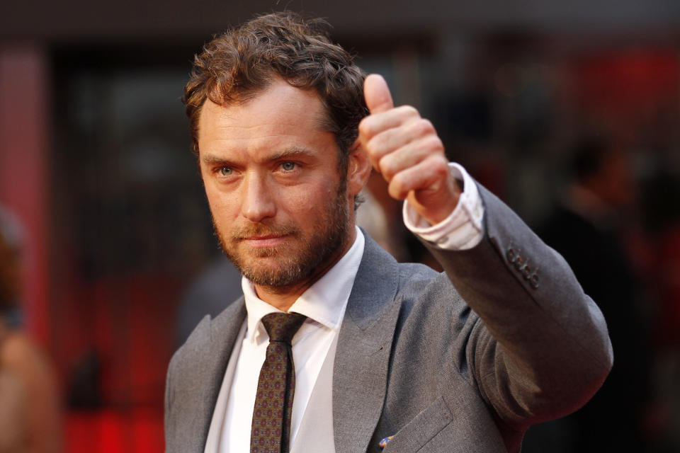 Cast member British actor Jude Law poses as he arrives for the world premiere of Anna Karenina in London, Tuesday, Sept. 4, 2012. (AP Photo/Sang Tan)