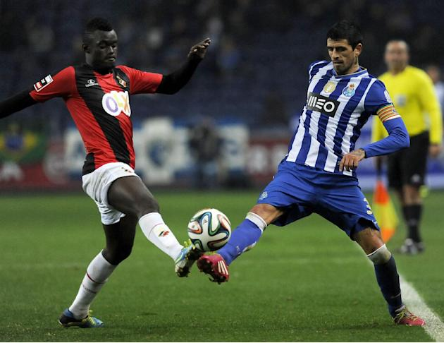 "FC Porto's Lucho Gonzalez, from Argentina, vies Olhanense's Judilson ""Pele"" Gomes, left, in a Portuguese League soccer match at the Dragao Stadium in Porto, Portugal, Friday, Dec. 20"