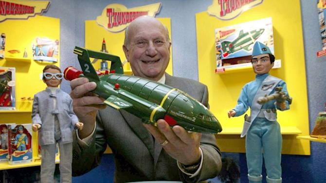 "FILE - In this Jan. 27, 2005 file photo, Gerry Anderson, poses for a photograph with a toy Thunderbird 2 on the 40th anniversary of the Thunderbirds first broadcast, in London. Anderson, the British creator of the hit ""Thunderbirds"" TV show, died Wednesday, Dec. 26, 2012 at age 83. He is survived by his wife, son Jerry, and three other children. (AP Photo/PA, Hugo Philpot, File) UNITED KINGDOM OUT, NO SALES, NO ARCHIVE"