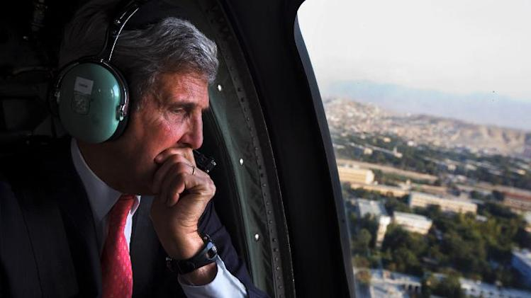 US Secretary of State John Kerry looks out of the window of a Black Hawk helicopter en route to ISAF Headquarters after an unannounced visit to meet with Afghan President Hamid Karzai, in Kabul on October 11, 2013