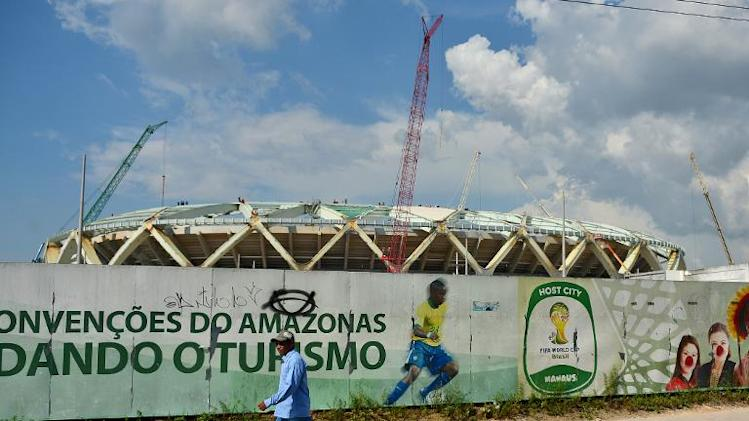 A man walks past the Arena Manaus stadium in Manaus, Brazil on December 10, 2013