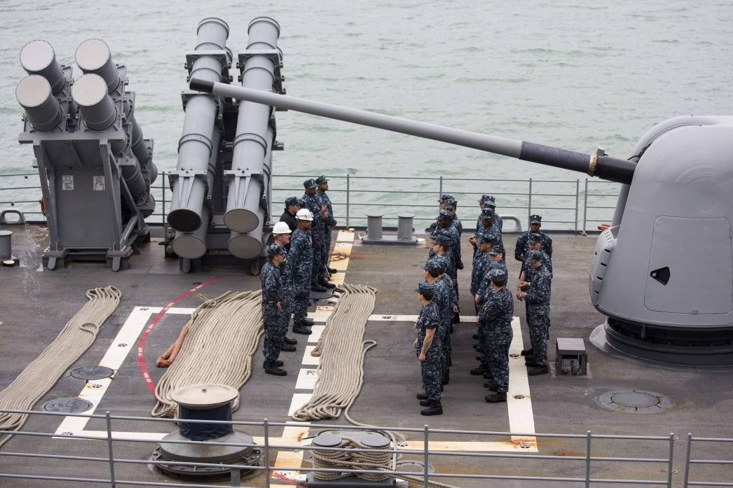 U.S. Navy sailors muster on the deck of the USS Antietam (CG-54) from the George Washington Battle Group before sailing to the Philippines at Hong Kong Victoria Harbor