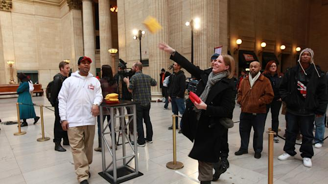 Consumer tosses bean bag at Wendy's new Right Price Right Size value menu challenge at Union Station, on Tuesday, Jan. 15, 2013 in Chicago. (Photo by Barry Brecheisen/Invision for Wendy's/AP Images)