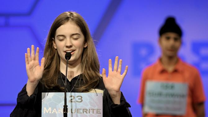 Marguerite Arbogast, 13, of Ludington Mich., spells her word during the second round of the Scripps National Spelling Bee in Oxon Hill, Md., Wednesday, May 29, 2013. (AP Photo/Cliff Owen)