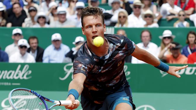 Berdych of the Czech Republic returns the ball to Monfils of France during their men's singles semi-final tennis match at the Monte Carlo Masters in Monaco
