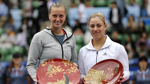 Petra Kvitova (L) of the Czech Republic and Angelique Kerber of Germany pose with their trophies after their singles final match at the Pan Pacific Open tennis tournament in Tokyo September 28, 2013 (Reuters)