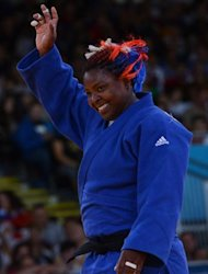 Cuba's Idalys Ortiz (blue) celebrates winning against China's Tong Wen (white) during their women's +78kg judo contest semi-final match of the London 2012 Olympic Games on August 3, 2012 at the ExCel arena in London.     AFP PHOTO / EMMANUEL DUNAND