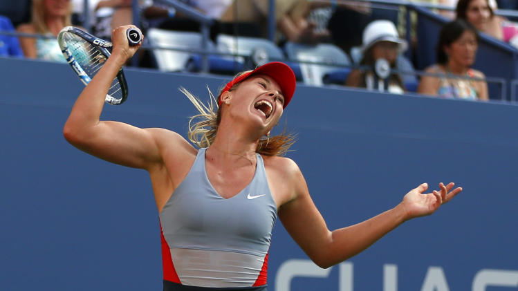 Maria Sharapova, of Russia, follows through on a shot against Alexandra Dulgheru, of Romania, during the second round of the 2014 U.S. Open tennis tournament, Wednesday, Aug. 27, 2014, in New York. (AP Photo/Matt Rourke)
