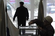 Russian citizens vote in presidential elections at a polling station inside a local drama theatre in the Kyrgyz capital Bishkek on March 4. Moscow's unexpected move to expell USAID appears part of an increasing crackdown in Russia on civil society after President Vladimir Putin's return to the Kremlin for a third term in May amid an outburst of street protests